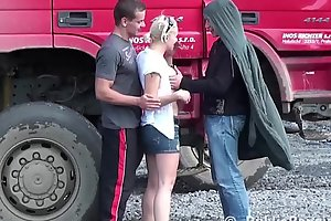 Young cute blonde girl public sex threesome at a construction site