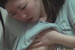 Asian babe toys her vag