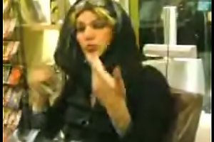 tits showing in shop woman iranian