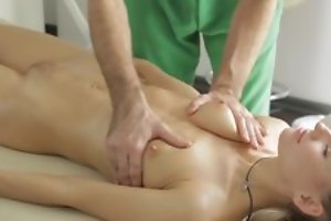Masseur does fantastic massage to young lady, then she sucks his dick in blowjob act and they fuck in nice hardcore sex act!