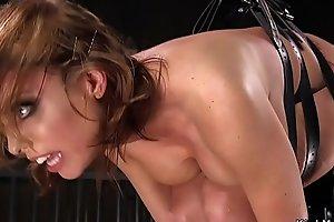 Busty brunette hanged in dungeon