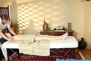 Filmed young beauty gets massaged
