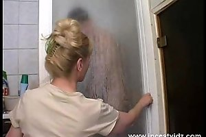 Mature mommy and her son on the shower