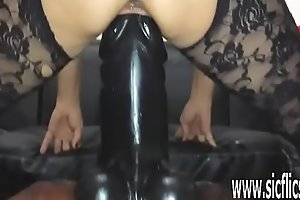 Sarah fucks a colossal dildo in her greedy love tunnel