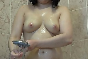 Brunette with racy ass takes a shower and spasmodically masturbates with cream, hawt fingering.